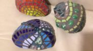 "3 Mosaic stones ""Tangaroa"" ""Papatuanuku"" and ""Ra"" range between 12-15cm in diameter. Artist: Rebecca Faull."